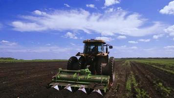 Agriculture tractor seeding plants