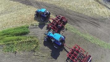 Up over  agricultural tractors. Aerial video
