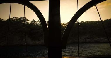 View through the side of a boat at sunset