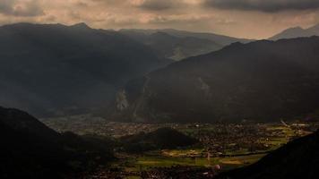 Interlaken village and valley sunbeams at sunset