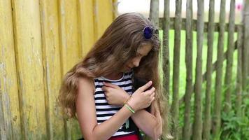 Pretty girl holds in hands black little kitten