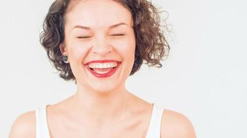 Young attractive woman is laughing merrily