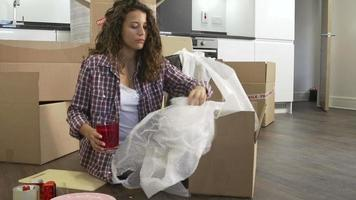 Woman Sealing Boxes Ready For House Move video