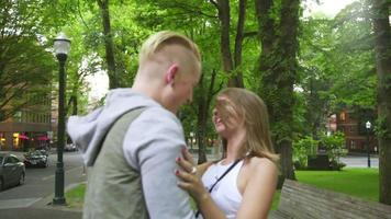 Couple laughs together in a park video