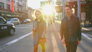 Medium shot of couple walking together video
