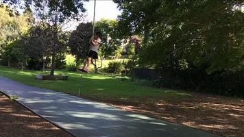 Child girl slide on flying fox