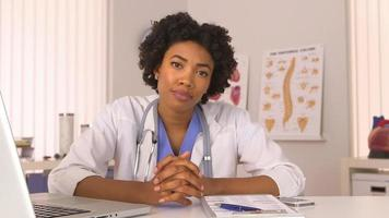 African American woman doctor listening