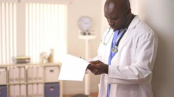 African American Doctor reviewing paperwork