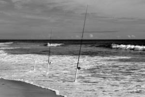 Fishing poles in the ocean