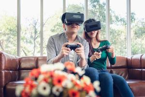 Young couple having fun while playing virtual reality game photo