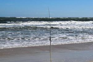 Fishing pole on the beach photo