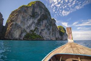 View of large rock from longtail boat in Thailand.