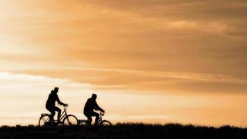Two people bicycling photo