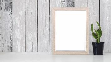 Wooden picture frame mockup with a cactus