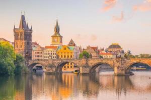 Famous iconic image of Charles Bridge and Prague city skyline photo
