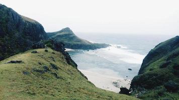 Green mountains near seashore