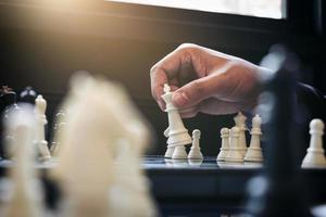 Close-up of a person playing chess photo
