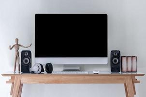Desktop mockup on a desk with wooden model