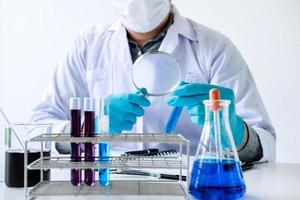 Chemist analyzing sample in laboratory