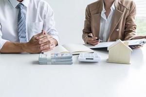 Real estate broker assisting client