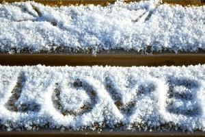 Love written in snow photo