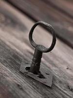 Metal key on a wooden door