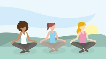 mulheres meditando ao ar livre