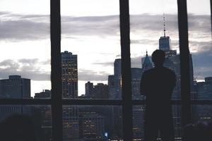 Man standing near city window