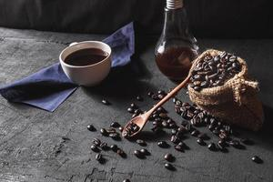Hot coffee and raw coffee beans photo