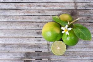 Top view of limes on a wooden surface