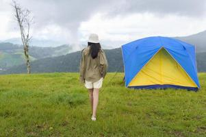 Traveler with a blue and yellow tent
