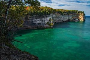 Green ocean near rocky coast