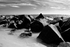 Large rocks in the ocean photo