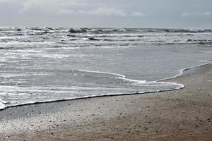 Ocean waves at the beach photo