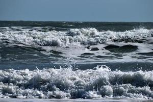 Ocean waves crashing at the beach photo
