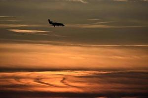 Silhouette of an aeroplane at sunset