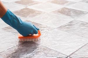 Close-up of a person cleaning tile