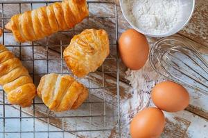 Homemade bread with egg and bowl of flour