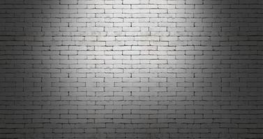 White brick wall on dark room background