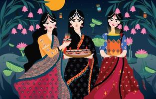 Three women celebrating Diwali at night