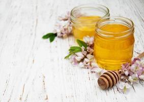 honey with acacia blossoms photo