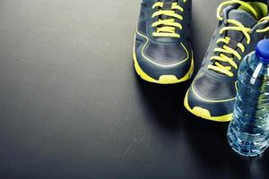 Sport shoes and water photo