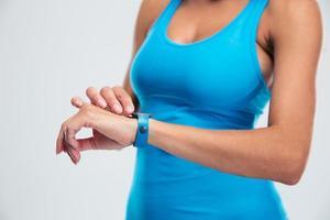 Woman using fitness tracker on wrist photo
