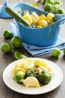 Baked pasta with brussels sprouts. photo