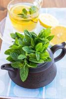 Cup of tea with mint and lemon photo