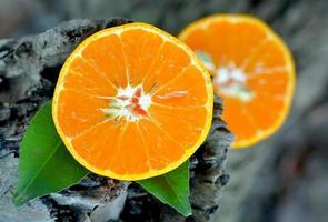 Orange fruit on a wooden background photo