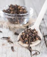 Cloves on a wooden spoon
