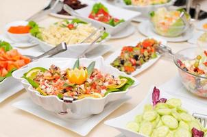 Diversity of salads on the table photo