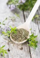 Dried Winter Savory on a cooking spoon
