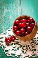 Fresh summer cherries,wooden background,healthy food.